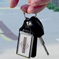 porte clé publicitaire metal et cuir 40x25