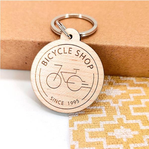 Porte-clés en bois gravé logo professionnel publicité entreprise vélo